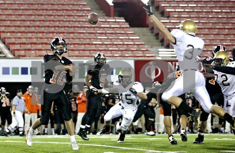Rob Winner  -  rwinner@daily-chronicle.com<br /> <br /> DeKalb quarterback Brian Sisler passes during the second quarter in DeKalb, Ill. on Friday September 10, 2010.