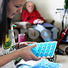Rob Winner – rwinner@daily-chronicle.com<br /> Megan Gommel, granddaughter of Louis Meinert, sorts her grandfather's prescriptions at his home in DeKalb, Ill. on Saturday February 6, 2010.