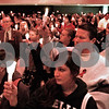 "Kyle Bursaw - kbursaw@daily-chronicle.com<br /> <br /> The entire community gathering raises their candles in unison to honor Antinette ""Toni"" Keller at the Holmes Student Center at NIU in DeKalb on Tuesday, October 26, 2010"