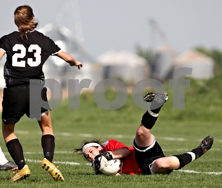 Beck Diefenbach  -  bdiefenbach@daily-chronicle.com<br /> <br /> Kaneland goalie Jordan Ginther blocks another shot attempt by Sycamore during the first half of the game at Kaneland High School in Maple Park, Ill., on Thursday May 6, 2010. Kaneland defeated Sycamore 1 to 0.