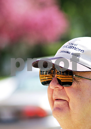 Beck Diefenbach  -  bdiefenbach@daily-chronicle.com<br /> <br /> Sycamore crossing guard Jack Knudson watches traffic outside Sycamore High School in Sycamore, Ill., on Thursday April 29, 2010.