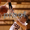 Beck Diefenbach  -  bdiefenbach@daily-chronicle.com<br /> <br /> DeKalb's Dylan Donnelly (12) loses the ball during a shot during the first quarter of the game against Geneva at DeKalb High School, in DeKalb, Ill., on Friday Jan. 5, 2010. DeKalb defeated Geneva 55 to 52.