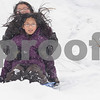 Kyle Bursaw – kbursaw@daily-chronicle.com<br /> <br /> Sisters Lorena, front, and Cecilia Robles fly down hill together on a sled in their neighborhood in DeKalb, Ill. on Friday, Dec. 24, 2010.