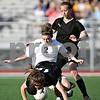 Beck Diefenbach  -  bdiefenbach@daily-chronicle.com<br /> <br /> Sycamore's Kim Norman (23, top right) watches as Ali Schroeder (12, bottom) and DeKalb's Allison Anderson (2) take a spill during the second half of the game at Northern Illinois University in DeKalb, Ill., on Thursday April 29, 2010. Sycamore defeated DeKalb 2 to 0.