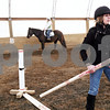 Beck Diefenbach - bdiefenbach@daily-chronicle.com<br /> <br /> Barn manager Abbie Jossart sets up a corse during a riding lesson at Runaway Ranch in Sycamore, Ill., on Tuesday March 9, 2010. Teaching riding lessons helps Jossart pay the costs for owning her own horse.