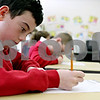 Rob Winner – rwinner@daily-chronicle.com<br /> Adam Tumminaro, 9, works on some multiplication problems at St. Mary Catholic School in DeKalb, Ill. on Tuesday January 12, 2010.