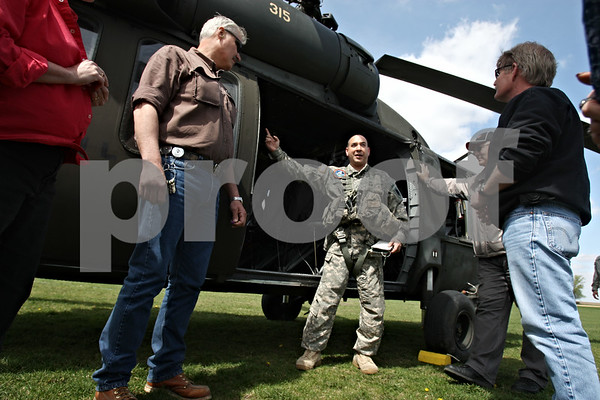 Rob Winner – rwinner@daily-chronicle.com<br /> <br /> In a lacrosse field just north of the Convocation Center in DeKalb, Ill. on Friday April 16, 2010, Sgt. Dan Delapeña instructs a group Northern Illinois University officials before a flight in a Black Hawk helicopter.