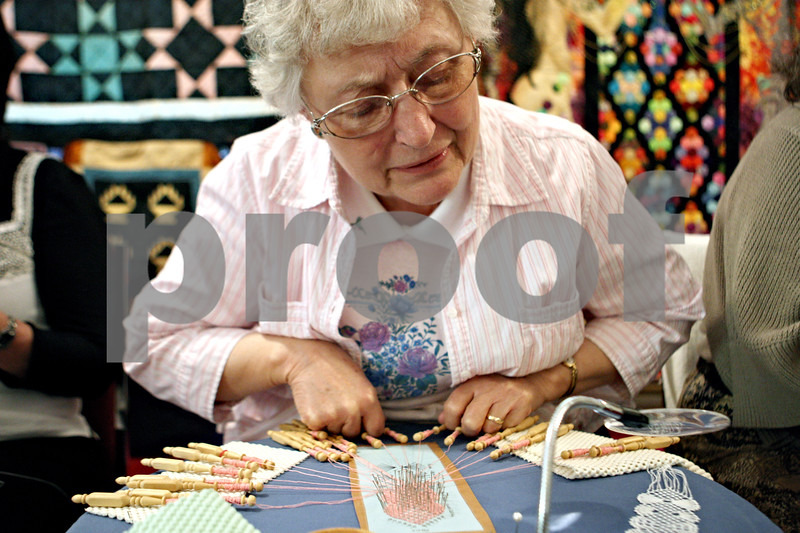 Rob Winner – rwinner@daily-chronicle.com<br /> <br /> At the Kirkland Historical Society Quilt Show at United Methodist Church in Kirkland, Ill. on Saturday March 20, 2010, Amelia Giese, of Belvidere, creates a bobbin lace bookmark.