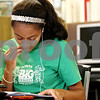 Rob Winner – rwinner@daily-chronicle.com<br /> <br /> Cortland resident Jasmine Olaldle, 16, works on a school project at the Cortland Public Library in Cortland, Ill. on Friday October 8, 2010.