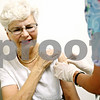 Rob Winner – rwinner@daily-chronicle.com<br /> <br /> DeKalb resident Kathy Buckner has a bandage placed on her left arm by registered nurse Pat Dashney after a flu shot at the DeKalb County Health Department in DeKalb, Ill. on Thursday September 16, 2010. Buckner makes sure to get a flu shot every year.