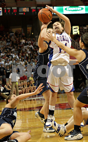 Beck Diefenbach - bdiefenbach@daily-chronicle.com<br /> <br /> Hinckley-Big Rock's Kaitlin Phillips is fouled while shooting the ball during the third quarter of the IHSA Class 1A semifinal game against Ridgewood at the Red Bird Arena on the campus of Illinois State University in Bloomington, Ill., on Friday Feb. 26, 2010.