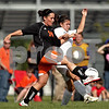 Beck Diefenbach  -  bdiefenbach@daily-chronicle.com<br /> <br /> DeKalb Jennifer Dorland (14, left) and Sycamore's Emma Norris (7) fight for the ball during the second half of the IHSA Class 2A Rochelle Regional Championship at Rochelle Township High School in Rochelle, Ill., on Friday May 21, 2010. Sycamore defeated DeKalb 2 to 1.