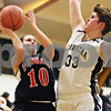 Rob Winner – rwinner@daily-chronicle.com<br /> <br /> Indian Creek's Anna Stiker (10) takes a shot which is blocked by Hiawatha's Randi Maynard during the third quarter in Kirkland on Thursday night. Indian Creek went on to defeat Hiawatha, 43-40.