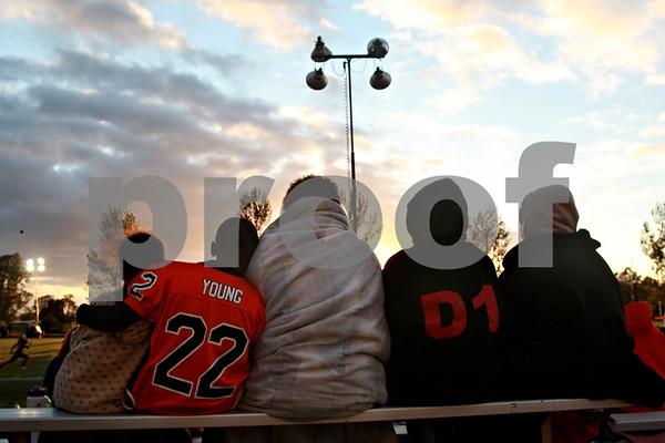 Beck Diefenbach  -  bdiefenbach@daily-chronicle.com<br /> <br /> The Parker and Vannoy families huddle for warmth before the start of DeKalb football's game against Hampshire at DeKalb High School in DeKalb, Ill., on Friday Sept. 3, 2010.