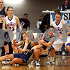 Rob Winner – rwinner@daily-chronicle.com<br /> Ottawa Marquette's Megan Dougherty (left) and Jessica Jessen (right) collide with Hinckley-Big Rock's Maxzine Rossler (center) for a loose ball during the first half of their sectional game at Mooseheart on Tuesday night.