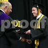Wendy Kemp/For The Daily Chronicle<br /> Aaron Klein receives his diploma during the graduation ceremony at Sycamore High School on Sunday.<br /> Sycamore 5/30/10