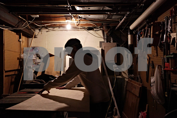 Beck Diefenbach – bdiefenbach@daily-chornicle.com<br /> <br /> Utilizing a table saw in his parent's basement, Kevin cuts pieces of wood for the dresser on Jan 12, 2009.