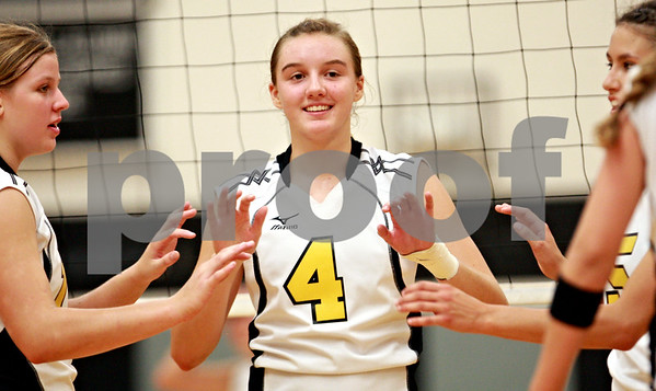 Beck Diefenbach – bdiefenbach@daily-chronicle.com<br /> <br /> Sycamore's Ratasha Garbes (4) celebrates as her team increases their lead over Kaneland during the second game at Kaneland High School in Maple Park, Ill., on Tuesday Sept. 21, 2010.