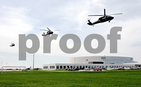 Rob Winner – rwinner@daily-chronicle.com<br /> <br /> Three Black Hawk helicopters fly past the Convocation Center for a landing at a nearby athletic field in DeKalb, Ill. on Friday April 16, 2010.