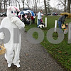 Rob Winner – rwinner@daily-chronicle.com<br /> <br /> Undeterred by morning rain showers, the Easter Bunny visited Hopkins Park in DeKalb, Ill. for an egg hunt on Saturday April 3, 2010. Youngsters old enough to walk up through fifth grade were invited to hop on and help clean the park of colored plastic eggs dropped by the Easter Bunny.