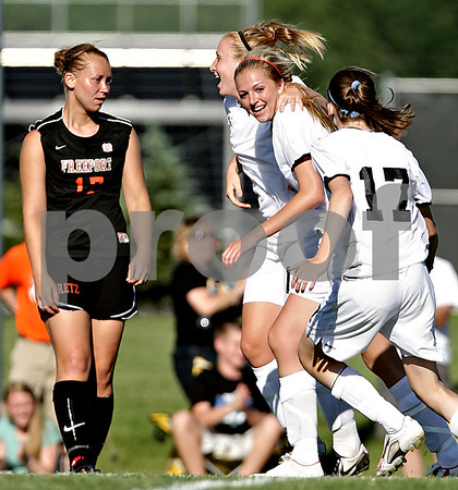Beck Diefenbach  -  bdiefenbach@daily-chronicle.com<br /> <br /> Sycamore's Rachel Stueber (22, center) is congratulated after her second goal during the first half of the IHSA Class 2A sectional final game against Freeport at Hampshire High School in Hampshire, Ill., on Friday May 28, 2010.