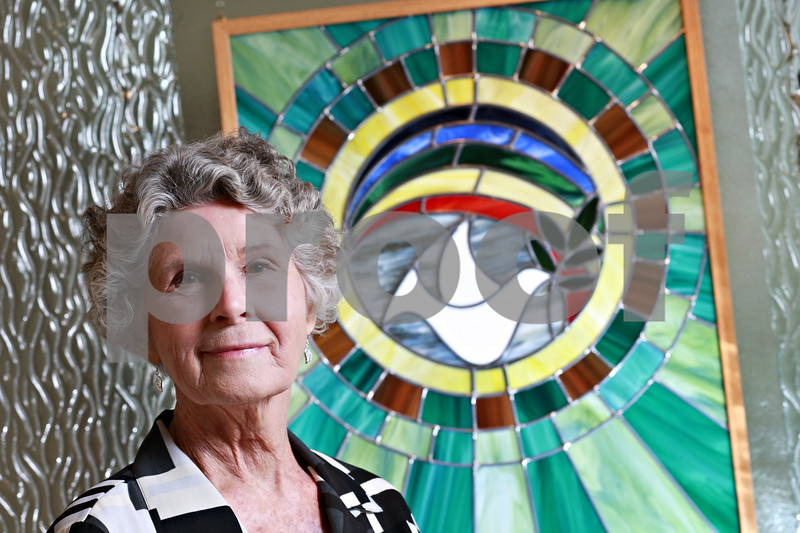 Beck Diefenbach – bdiefenbach@daily-chronicle.com<br /> <br /> Typically administering the front desk the Kishwuakee Community Hospital as volunteer, Maggie Hertel restored the broken stained glass pieces for the hospital's chapel. Hertel also replaced several pieces of glass to make the colors match those of the interior of the hospital.