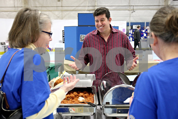 Rob Winner – rwinner@daily-chronicle.com<br /> <br /> Starbusters owner Nick Tsiftilis (center) talks with Nancy Castle (left) and Mary Perhay, both of Kishwaukee Sunrise Rotary, during the Link Up Expo at the Kishwaukee Family YMCA in DeKalb, Ill. on Tuesday May 11, 2010.