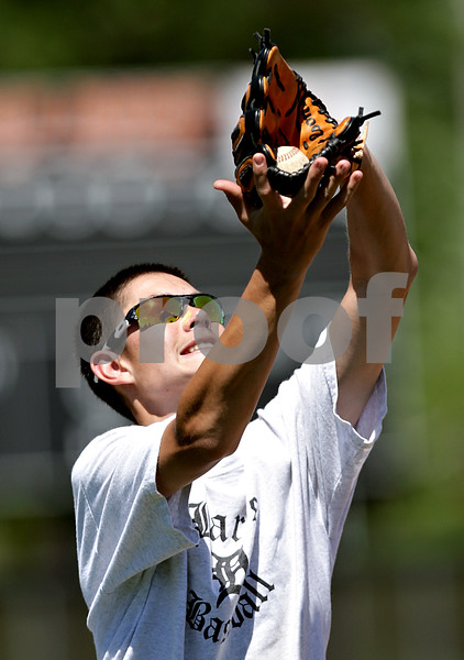 Beck Diefenbach  -  bdiefenbach@daily-chronicle.com<br /> <br /> DeKalb's Luke Hayes catches a ball during practice at DeKalb High School in DeKalb, Ill., on Wednesday June 9, 2010.