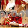 Rob Winner – rwinner@daily-chronicle.com<br /> Batavia's Ricky Clopton looks to pass from the floor during the third quarter. Batavia defeated Sycamore on Friday February 19, 2010 in Sycamore, Ill., 68-63.
