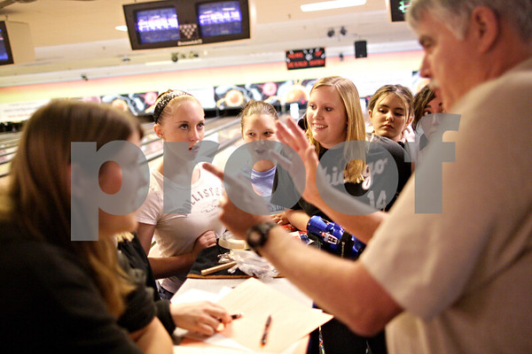 Beck Diefenbach  -  bdiefenbach@daily-chronicle.com<br /> <br /> Members of the DeKalb girls bowling team, including (from left) sophomore Alyssa Mershon, senior Cassy Burright and senior Catlyn Cochrane listen as head coach Bill Holland (far right) leads bowling practice at Mardi Gras Lanes in DeKalb, Ill., on Tuesday Feb. 9, 2010.
