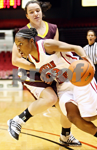 Rob Winner – rwinner@daily-chronicle.com<br /> <br /> Northern Illinois guard Marke Freeman (23) is fouled by Loyola guard Monica Albano during the first half in DeKalb, Ill. on Tuesday, Dec. 28, 2010.