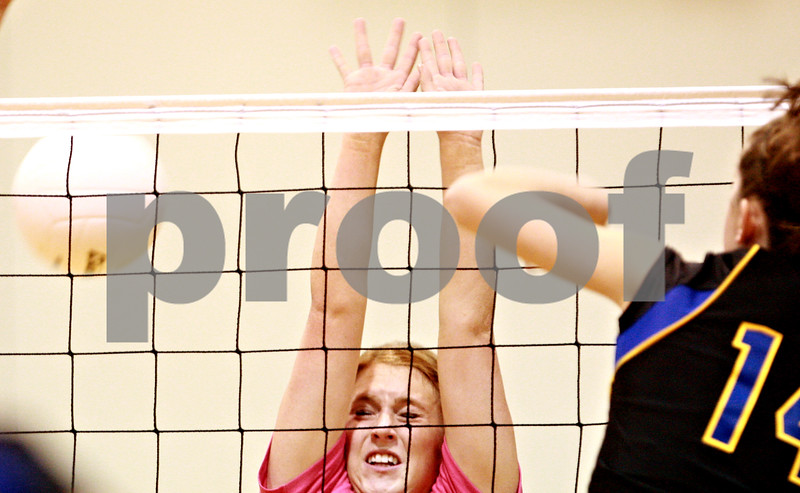 Beck Diefenbach – bdiefenbach@daily-chronicle.com<br /> <br /> Hinckley-Big Rock's Rachel Michaels attempts to block a shot during the first game against Somonauk in the Little 10 Conference Volleyball Tournament at H-BR High School in Hinckley, Ill., on Tuesday Oct. 5, 2010.