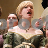 Kyle Bursaw – kbursaw@daily-chronicle.com<br /> <br /> DeKalb High School Madrigals from left, Justin Gingrich, Autumn Brandon, Jenn Jesmer and others perform at the Egyptian Theatre prior to Santa arriving on Thursday, Dec. 2, 2010.