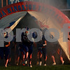 Beck Diefenbach  -  bdiefenbach@daily-chronicle.com<br /> <br /> The Genoa-Kingston football team enters the field before their game against Aurora Central Catholic at Genoa-Kingston High school in Genoa, Ill., on Friday Aug. 27, 2010.