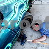 Beck Diefenbach  -  bdiefenbach@daily-chronicle.com<br /> <br /> Chad Askeland lines up his car jack before replacing a wheel on his race car before his race at the Sycamore Speedway on Friday July 2, 2010. Askeland is the current point leader in the Compact Combat division.