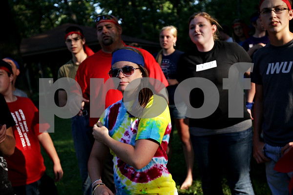 Beck Diefenbach  -  bdiefenbach@daily-chronicle.com<br /> <br /> Members of the blue and red team combine before attacking the green team during a capture the flag tournament at Chief Shabbona Forest Preserve for youth members of the Village Bible Church on Wednesday June 30, 2010.