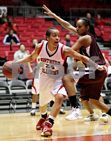 Beck Diefenbach  -  bdiefenbach@daily-chronicle.com<br /> <br /> Northern Illinois' Sarah Rogers (24, left) dribbles past Central Michigan's Shonda Long (3) during the first half of the game at the NIU Convocation Center in DeKalb, Ill., on Wednesday Jan. 20, 2010