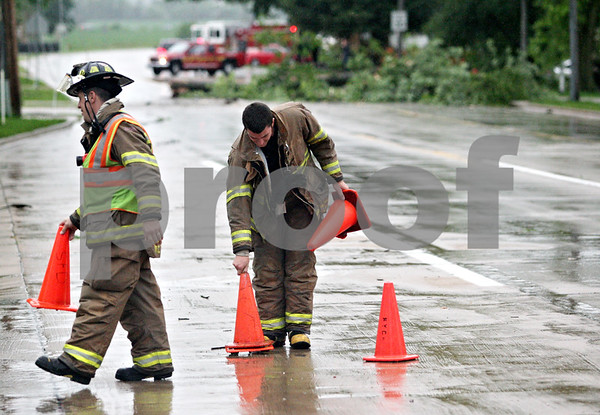 Beck Diefenbach  -  bdiefenbach@daily-chronicle.com<br /> <br /> Sycamore fire fighters close down West State Street in Sycamore after downed power lines began to spark on Friday June 18, 2010
