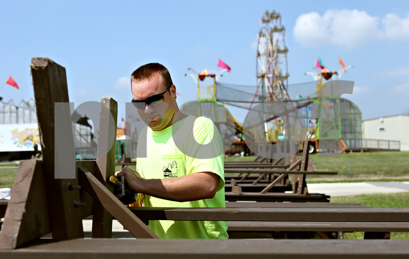Rob Winner  -  rwinner@daily-chronicle.com<br /> <br /> On Thursday August 19, 2010, Matt Anderson, of the DeKalb Park District, prepares picnic tables for visitors to this weekend's Corn Fest at the DeKalb Taylor Municipal Airport in DeKalb, Ill.