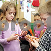 Rob Winner – rwinner@daily-chronicle.com<br /> <br /> First grade students Antoinette Leblanc (left) and Evan Braffett, of Jefferson Elementary School in DeKalb, hold a corn snake on Monday afternoon in Cindy Warren-James' classroom.