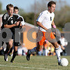 Rob Winner – rwinner@daily-chronicle.com<br /> <br /> DeKalb's Joe Ferguson (8) moves the ball as Sycamore's Trevor Cervenka (4) trails during the first half in DeKalb, Ill. on Thursday October 7, 2010. DeKalb defeated Sycamore, 2-1.