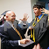 Beck Diefenbach  -  bdiefenbach@daily-chronicle.com<br /> <br /> Industrial technology teacher Phil Jerbi (center) fist bumps senior Gage Windau before the graduation ceremony with the at G-K High School in Genoa, Ill., on Tuesday May 18, 2010.