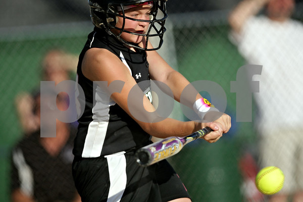 Beck Diefenbach  -  bdiefenbach@daily-chronicle.com<br /> <br /> Kishwuakee Valley Storm's Morgan Klassen (24) hits the ball during the 10U game against the St. Charles Comets in the pool play portion of the Storm Dayz softball tournament at Sycamore Park in Sycamore, Ill., on Friday June 25, 2010.