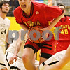 Rob Winner – rwinner@daily-chronicle.com<br /> Batavia's Elliott Vaughn drives to the basket during the second quarter of Friday night's game in Sycamore, Ill. Batavia defeated Sycamore, 68-63.