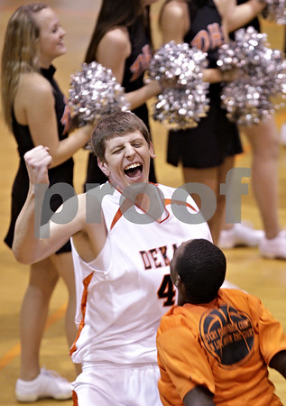 Beck Diefenbach  -  bdiefenbach@daily-chronicle.com<br /> <br /> Dekalb's Jordan Threloff (42) enters the court before the start of the game against Rochelle at DeKalb High School  in DeKalb, Ill., on Friday Jan. 8, 2010.