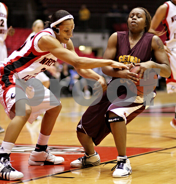Beck Diefenbach  -  bdiefenbach@daily-chronicle.com<br /> <br /> Northern Illinois' Bianca Brown (25, left) tries to take the ball from Central Michigan's Jalisa Olive (5) during the first half of the game at the NIU Convocation Center in DeKalb, Ill., on Wednesday Jan. 20, 2010