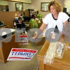 Rob Winner – rwinner@daily-chronicle.com<br /> <br /> Clay Campbell, who is running for state's attorney, and his secretary Sheri Wigant assemble campaign signs for Campbell at his law office in downtown Sycamore, Ill. on Wednesday October 6, 2010.
