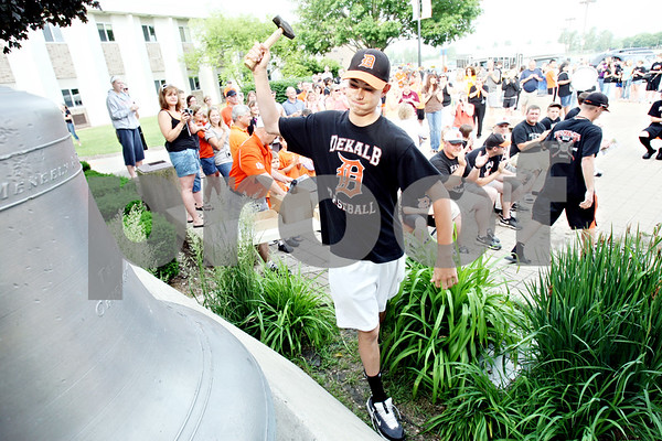 Rob Winner – rwinner@daily-chronicle.com<br /> <br /> Luke Hayes, an infielder for the Barbs, rings the bell in front of DeKalb High School in DeKalb, Ill. during a sendoff on the morning of Friday June 11, 2010. The Barbs were scheduled to play Marian in the IHSA Class 3A State semifinal on Friday.