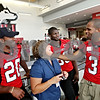 Beck Diefenbach  -  bdiefenbach@daily-chronicle.com<br /> <br /> Lorna Code (center), of DeKalb, talks with players (left), Landon Cox (back) and DeMarcus Grady (right) during the Northern Illinois University football 101 women's clinic at Huskie Stadium in DeKalb, Ill., on Tuesday July 27, 2010.