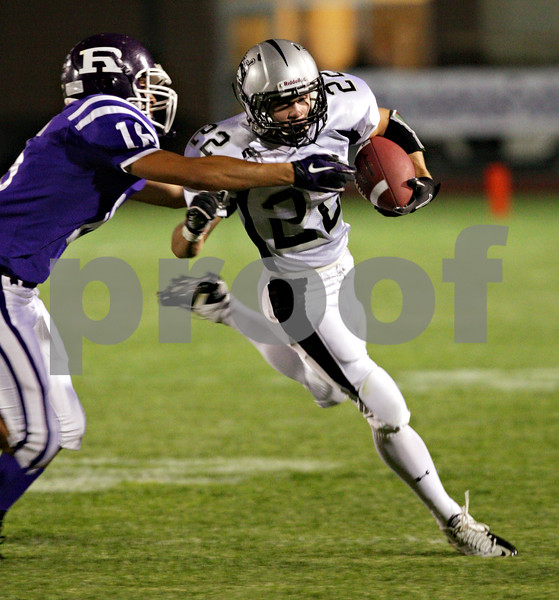 Beck Diefenbach – bdiefenbach@daily-chronicle.com<br /> <br /> Kaneland wide receiver Quinn Buschbacher (22) runs with the ball during the first quarter of the game against Rochelle at Rochelle High School in Rochelle, Ill., on Friday sept. 24, 2010.